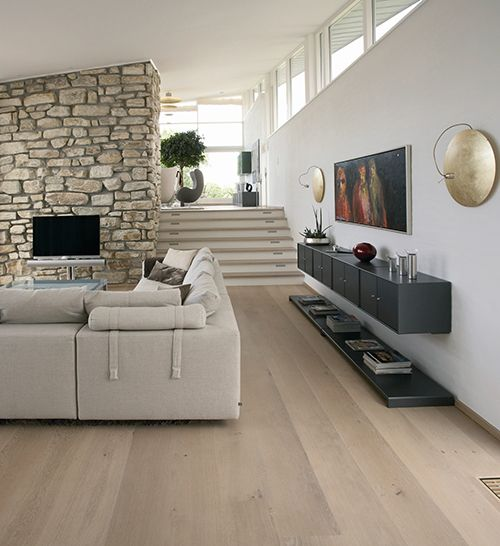 Light wooden floor. Stone wall and large stairs