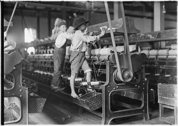 Bibb Mill No. 1, Macon, Ga. Many youngsters here. Some boys and girls were so small they had to climb up on to the spinning frame to mend broken threads and to put back the empty bobbins, January 1909 | Photographer: Louis Wickes Hines (pinned by haw-creek.com)