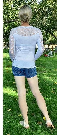 a white bra and white lace top from behind with short-shorts