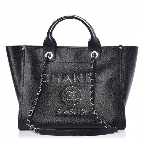 137c1521e188 This is an authentic CHANEL Caviar Small Studded Deauville Tote in Black.  This stylish hand bag is crafted of grained caviar leather in black with a  studded ...