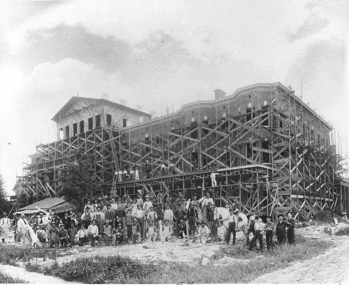1899: St. Joseph Sanitarium and Bath House under construction in 1899. he facility was built at 215 North Avenue by the Sisters of Charity of St. Joseph. The architect was Theophilus Van Damme of Mount Clemens. Hospital beds were added in 1900 and bath house operations were gradually phased out, and the institution became known as St. Joseph Mercy Hospital.