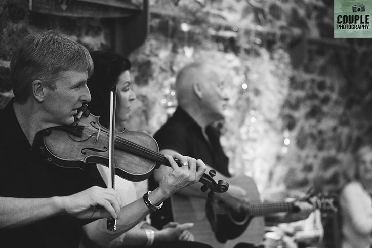 The Irish trad band gets the party started. Wedding in The Abbey Tavern, Howth. Photographed by Couple Photography.