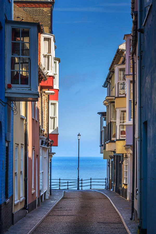 Cromer is a largely unremarkable English seaside town, famous for its crabs but not a lot else. Chris Warren's picture, looking down Jetty Street towards the open sea gives this 'gem of the Norfolk Coast' an exotic, almost Mediterranean air. The sky is unusually blue, the North Sea even more so and the light catching the jettied upper floors of the houses adds a warmth not always associated with this stretch of coastline | From 4cornersimages.com