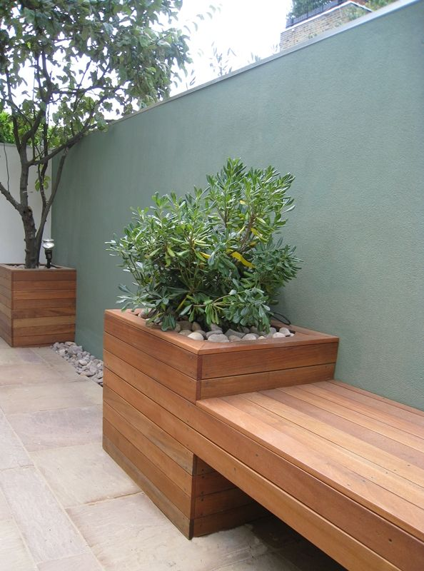 Balau hardwood floating bench with integrated raised planters