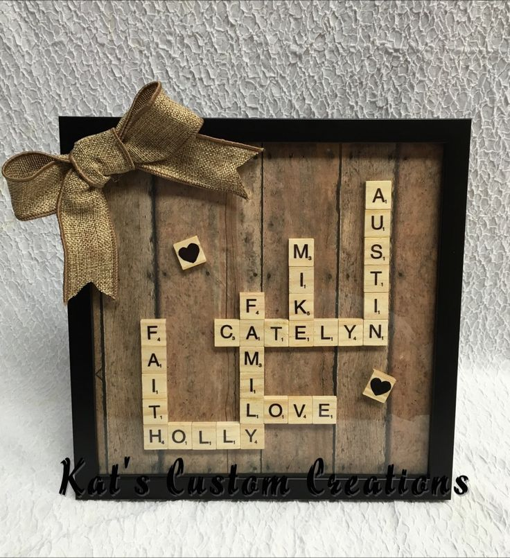 Scrabble Art family's names plus love, faith, and family. Scrabble letters in a shallow shadow box with burlap bow.