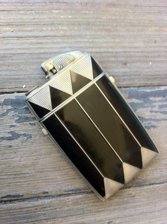 EVANS CASE Co. Art Deco Cigarette Case and Lighter, 1930s, displaying a geometric design in black enamel with a clipper-style butane lighter on the top.