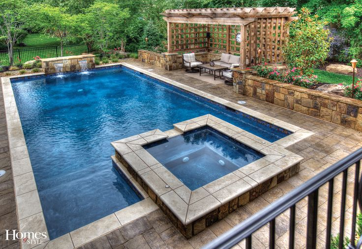 SwimThings designed and installed a heated 18-by-36-foot gunite pool with a marbled midnight blue finish. Frost-proof 6-by-6-inch ceramic tiles were used at the waterline while a natural travertine tile border frames the elegant pool and spa.  Rounding out the salt water pool's features are steps, a lap lane, a sun ledge and cozy spa at the shallow end of the pool and a custom copper sheer descent waterfall at the deep end.  Photo courtesy of Markline Photography