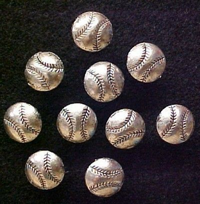 Baseballs decorative push pins for decorative cork bulletin boards. These decorative push pins are half round baseballs in nicely detailed Tibet Silver. Perfect for any baseball player, coach, baseball fan or cork bulletin board.