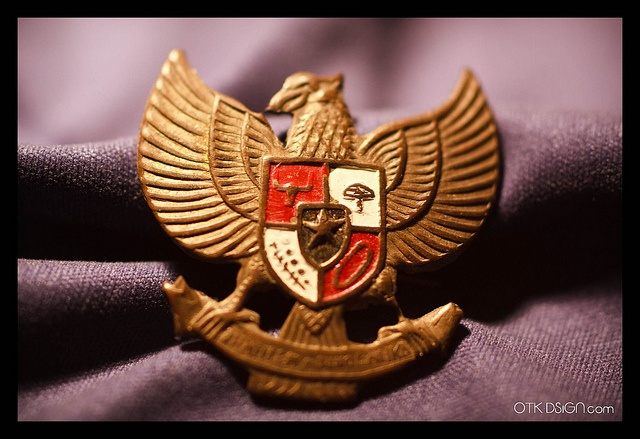 Garuda Pancasila is the National emblem of Indonesia. The main part of Indonesian national emblem is the Garuda with a heraldic shield on its chest and a scroll gripped by its legs. The shield's five emblems represent Pancasila, the five principles of Indonesia's national ideology.