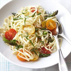 Asparagus and tomatoes are cooked with white wine, then tossed with the pasta and basil for this vegetarian main dish.