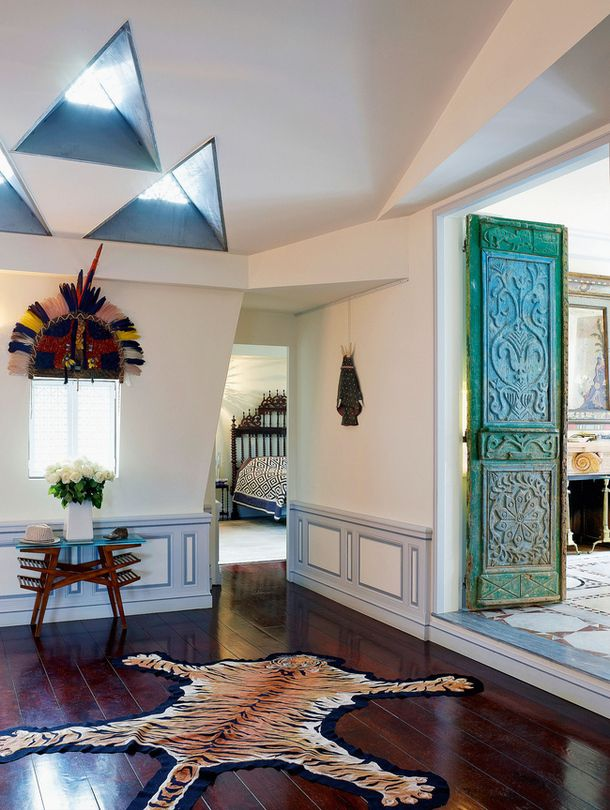 Christian louboutins paris attic filled with furniture and accessories from around the