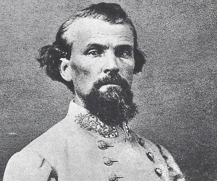 Nathan Bedford Forrest, a Civil War era asshole. After the Battle of Fort Pillow he ordered his men to murder over 200 Union troops that had thrown down their arms and surrendered.  This gaping asshole later became the first Grand Wizard of the Ku Klux Klan.  He is still revered by assholes in the southern US, of which there are many.  Fuck him and the confederate flag-waving assholes who think he's a hero.  I hope they all burn in hell with him someday.