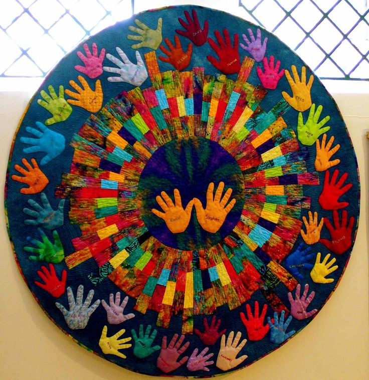 Great idea for a unique teacher gift, a hands quilt :)  This would be so cute to do -- collect kids' handprints and make a quilt after I have been teaching -- be sure to go back and get my first kindergartners while they are still in 1st grade!! :)