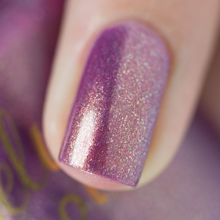 Close up of the color shifting shimmer in Love At First Bite nail polish.