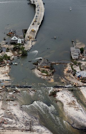 MANTOLOKING, NJ - OCTOBER 31: Destroyed homes are seen at the end of a bridge wrecked by flooding from Hurricane Sandy on October 31, 2012 in Mantoloking, New Jersey. At least 50 people were reportedly killed in the U.S. by Sandy with New Jersey suffering massive damage and power outages. Photo: Mario Tama, Getty Images / 2012 Getty Images