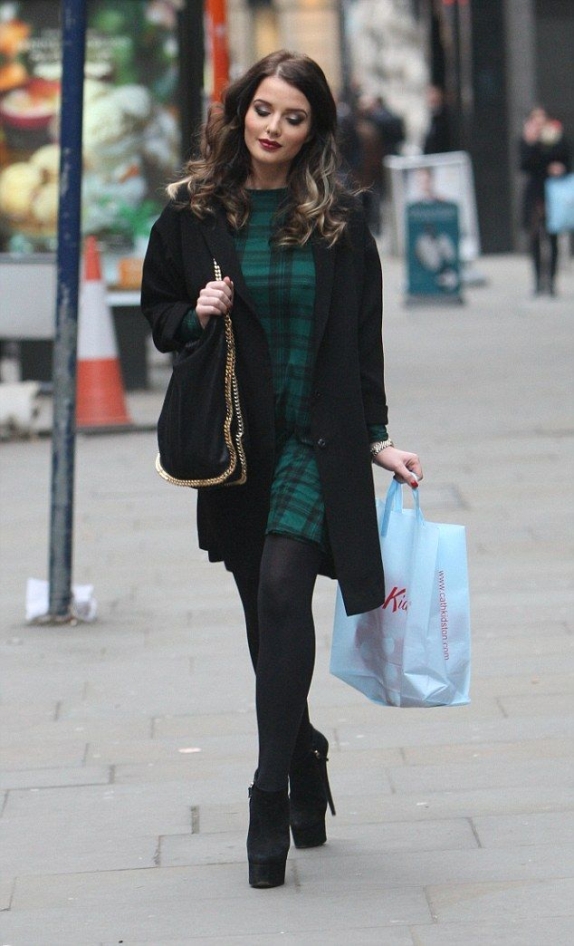 Solo shopping trip: The actress stepped out alone as she was seen visiting popular stores such a Burberry and Cath Kidson