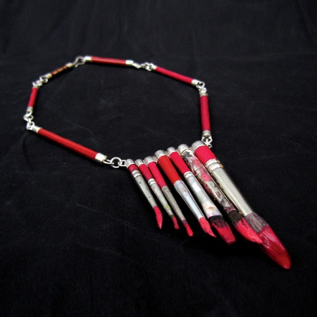 Amazing neckless with paint brushes by Elli Hukka.
