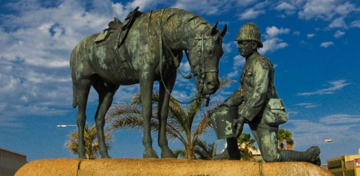 Horse Memorial - Port Elizabeth - A British trooper kneels before his horse, holding a bucket of water for his steed. It's the only horse memorial in South Africa, and it was erected by the local community. The inscription reads: 'The greatness of a nation consists not so much in the number of its people or the extent of its territory, as in the extent and justice of its compassion.'