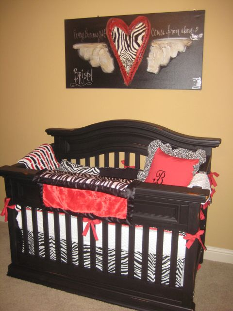 red crib bedding with zebra velour print on rustic furniture with zebra leopard