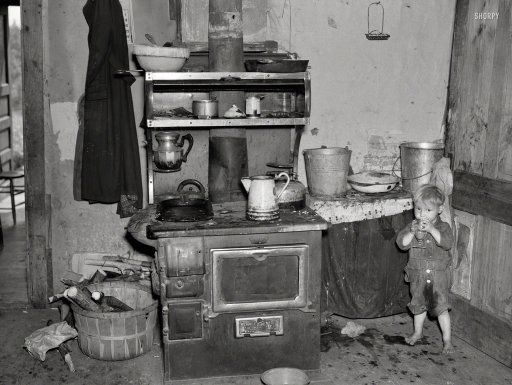"""June 1937. """"Child of Earl Taylor in kitchen of their home near Black River Falls, Wisconsin."""" Photo by Russell Lee, Resettlement Administration."""