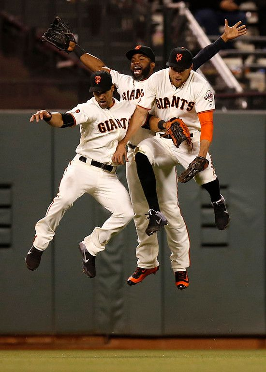 . San Francisco Giants\' Angel Pagan (16), San Francisco Giants\' Denard Span (2) and San Francisco Giants\' Hunter Pence (8) celebrate their 1-0 win over the San Diego Padres at AT&T Park in San Francisco, Calif., on Tuesday, April 26, 2016. (Nhat V. Meyer/Bay Area News Group)