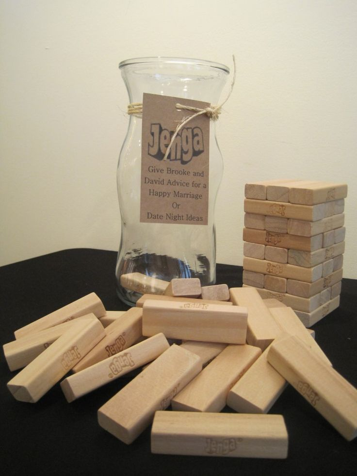 little heart cut outs to throw into a vase instead of janga pieces.. marriage advice or date night ideas from guests or dirty jenga as a gift...hee hee