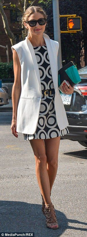 Best #streetstyle @ 2014 #NFW | Olivia Palermo in a white sleeveless blazer over a Desigual black & white dress paired with nude Aquazzura + Olivia Palermo lace up sandals and a turquoise pouch