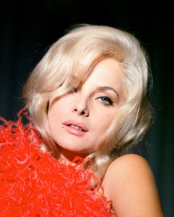 """Italian actress Virna Lisi posing for a portrait in the 1960s. Known for starring in films like """"How to Murder Your Wife"""" alongside Jack Lemon and """"Not with My Wife, You Don't!"""" with Tony Curtis,`"""