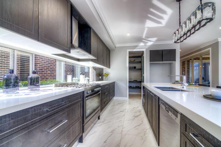 The Bronte kitchen. Timber, pendant,  tiles, rangehood, pantry, horizontal windows