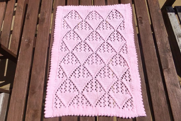 This little blanket, featuring a lace pattern and picot edging, measures approximately 53cms x 39cms. This would be suitable for a moses basket, modern pram or car seat. It's knitted in a babysoft yarn which can be machine washed at gentle and tumble dried at cool.  £22+ £2.80 P&P