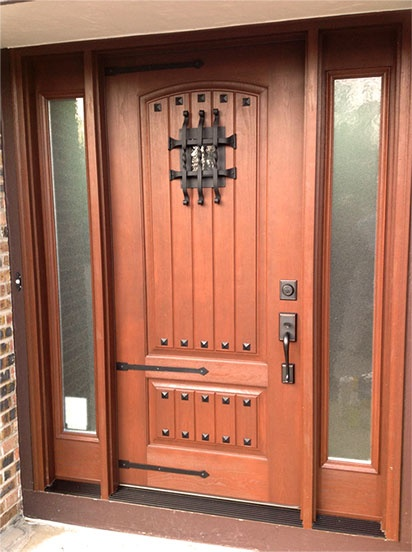 clopay rustic collection fiberglass entry door accented with a wrought iron twisted grille speak easy