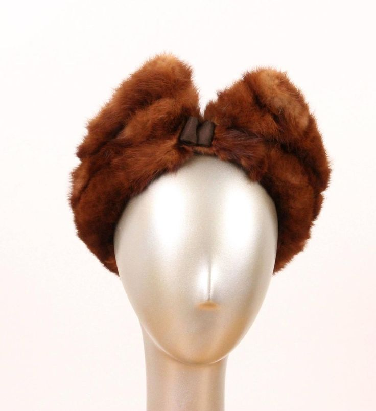 "In the 1940's the Merri-Mac Hat Corporation was the largest manufacturer of trimmed hats in the country. This hat is a classic example of a ""pompador"" style, which like the hair style of the same name, had most of its volume on the top and forward part of the head. This elegant design is of a supple mink built onto a felt base with a dainty grosgrain bow at its center front. It's the epitome of 1940's chic."