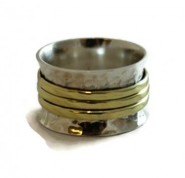 Sterling silver spinning ring with brass accents.