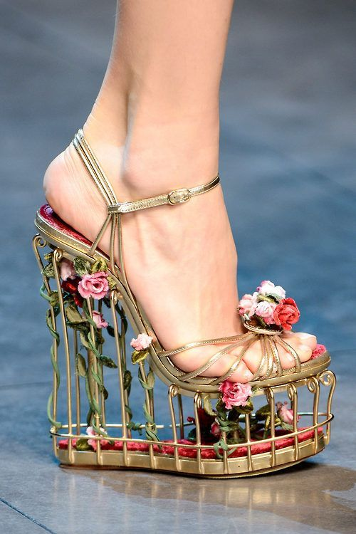 Crazy & awesome high heel shoes > resembles a birdcage decorated with vines and flowers.