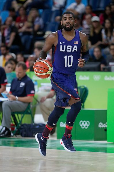 Kyrie Irving of United States drives the ball against Serbia during the Men's…
