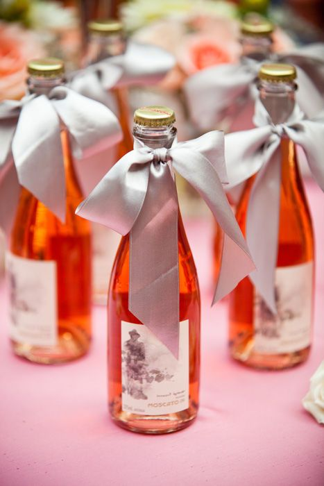 mini bottles tied w/ satin ribbon / bows. entertaining ideas.
