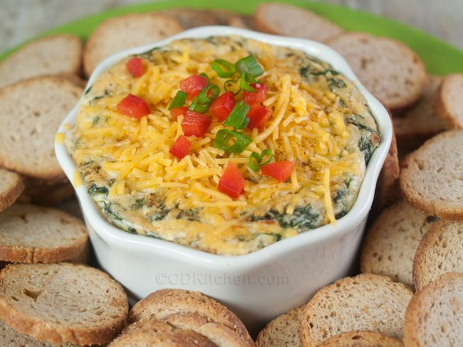 Kelsey's 4 Cheese Spinach Dip - CDKitchen.com -  Kelsey's got it right with this recipe! This restaurant favorite is made with cream cheese, Parmesan, Romano, chopped spinach, and topped with Cheddar cheese. Serve with fried pita wedges like Kelsey's does or use your favorite dippers.