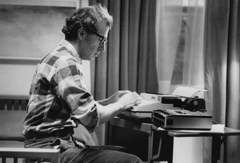 Woody Allen at his typewriter - an Olympia portable SM-3 - that he writes his scripts on, after writing them longhand on legal pads.