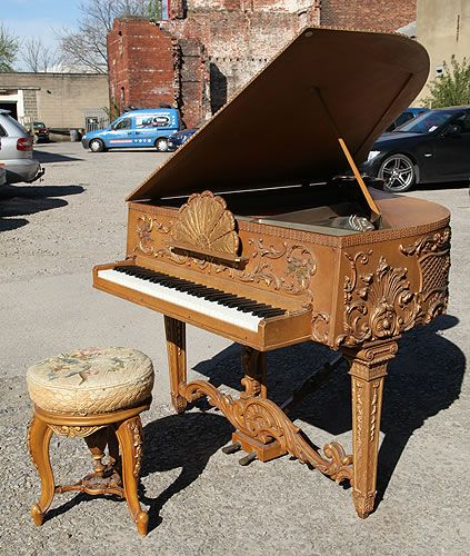 An Extremely Rare, Claviano Grand Piano For Sale with an Ornately Carved, Rococo Style Case with Gilt Detail and Hand Painted Panels. Piano Reputedly Built for Songwriter and Film star Ivor Novello. The Keyboard Spans Five and a Half Octaves and Has Been Strung Using Bichords at Besbrode Pianos