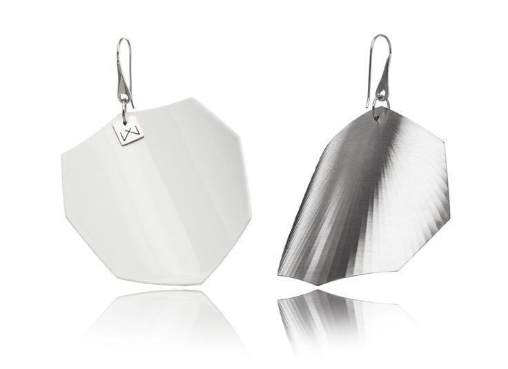 WHITE-OCTAGON-RHODIUM  Hanger: 925 STERLING silver with rhodium flashing.   Front part: colored, high gloss homogenous surface, UV-resistant.   Back part:  satin effect metal surface, rhodium coating (platinum flashing) in 3 layers.   Gloss preserving, wear-proof, oxidation resistant and anti-allergenic.  Available in three sizes: with a diameter of 4, 5 and 6 cms.