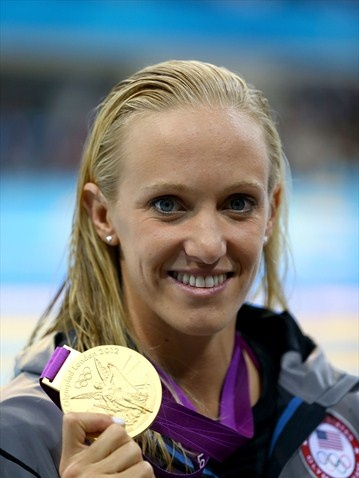 USA's Dana Vollmer celebrates winning gold and setting new world record in women's 100m Butterfly.