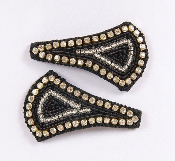 """A beautiful pair of hand embroidered broad triangular, almost kite shaped snap clips-""""tick tock clips"""". Black thread edging with diamonds and silver beading embroidery in the center. Snap clip, diamantes, hand embroidered. Black, Silver, Beading & Diamantes.  Broad triangle, almost kite shaped; Approx. 1 inches length by 1 1/2 inch width.  £8.00 on Etsy... Please click on the Etsy link to purchase."""