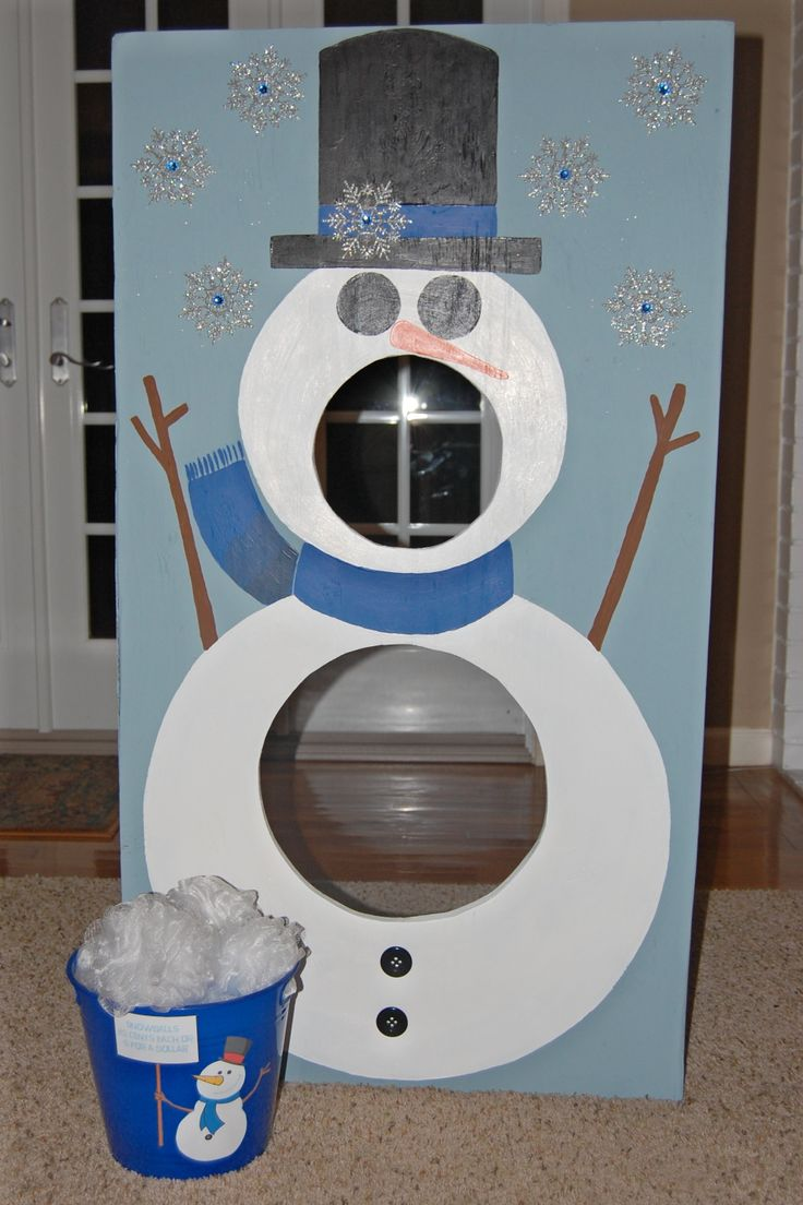 "Snowman bean bag toss with bucket of ""snowballs"" (white shower loofahs from the Dollar Tree)."