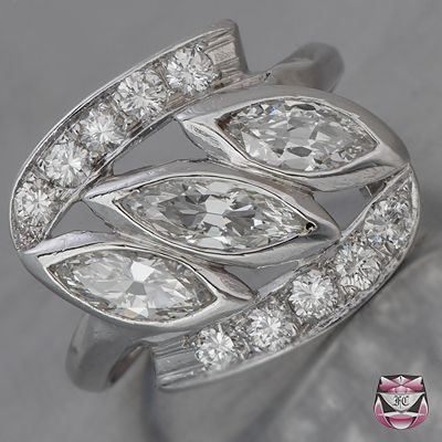 A stunning original 1950s engagement ring  with marquise diamonds set in platinum.This is a vintage original so there will only be one, but why not use it to inspire you for your own original bespoke vintage inspired engagement ring ?. If you'd like a vintage inspired ring made to your very own specification,  then visit us at www.designer-engagement-rings.co.uk. As leading UK  jewellery historians ,no one knows vintage as well as we do.