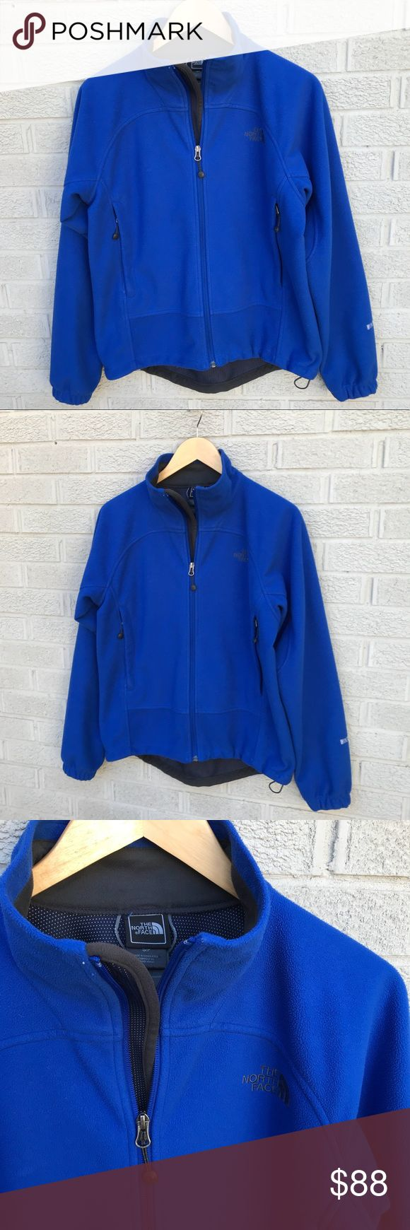 """The North Face Men's Windwall Fleece Zip Jacket North Face Men's Windwall Fleece Zip Jacket in Blue! Full Zip wind proof jacket! 2 Front zip pockets, hem cinch cord & elastic sleeve cuffs for added warmth! Longer length in Back. Size Small. 100% Poly. 21.5"""" across the chest & 23.5"""" long in front & 25.5"""" in back. Previously loved. A little faded. JS3598020118 The North Face Jackets & Coats Windbreakers"""