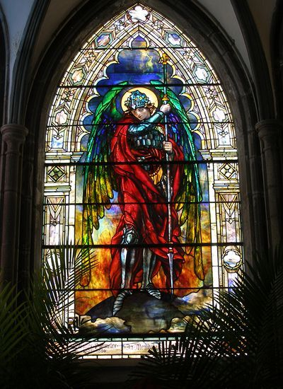 """Archangel Michael by Louis Comfort Tiffany.  Here the one who's name means: """"who is like God"""" has just defeated the devil."""
