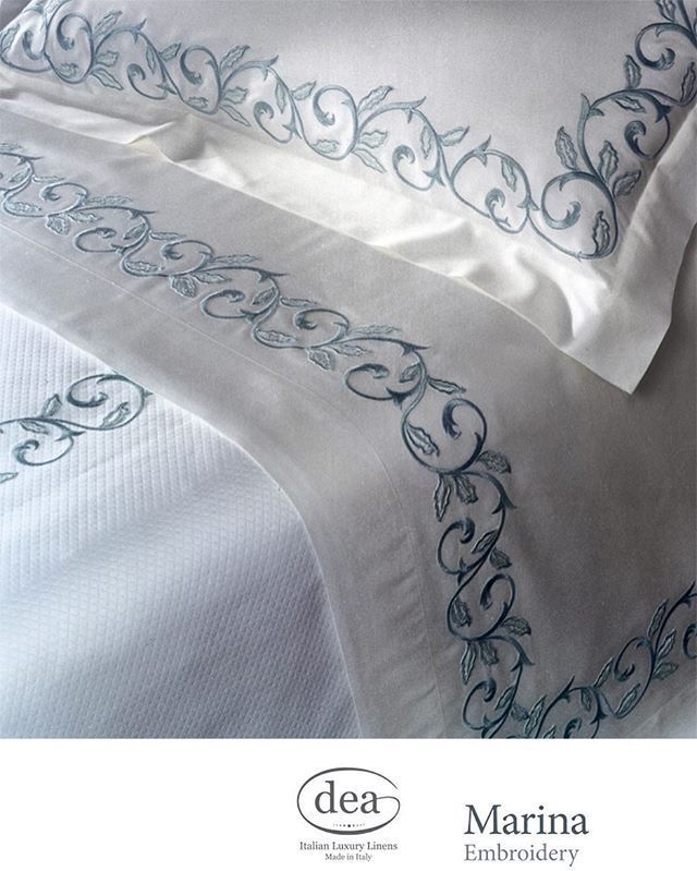 Gentle waves of soft blue embroidery tumble across the edges of our Marina bed sheets. | Dea Mantellassi | Dea Italian Linens