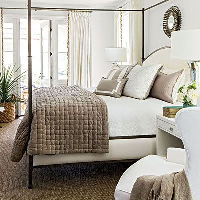 Master Suite: The Bedroom |  To give the room a water view, architect Ken Pursley placed it at the back of the house with a door leading off to the porch. Interior designer Suzanne Kasler positioned the bed between the windows so the water is always in sight.