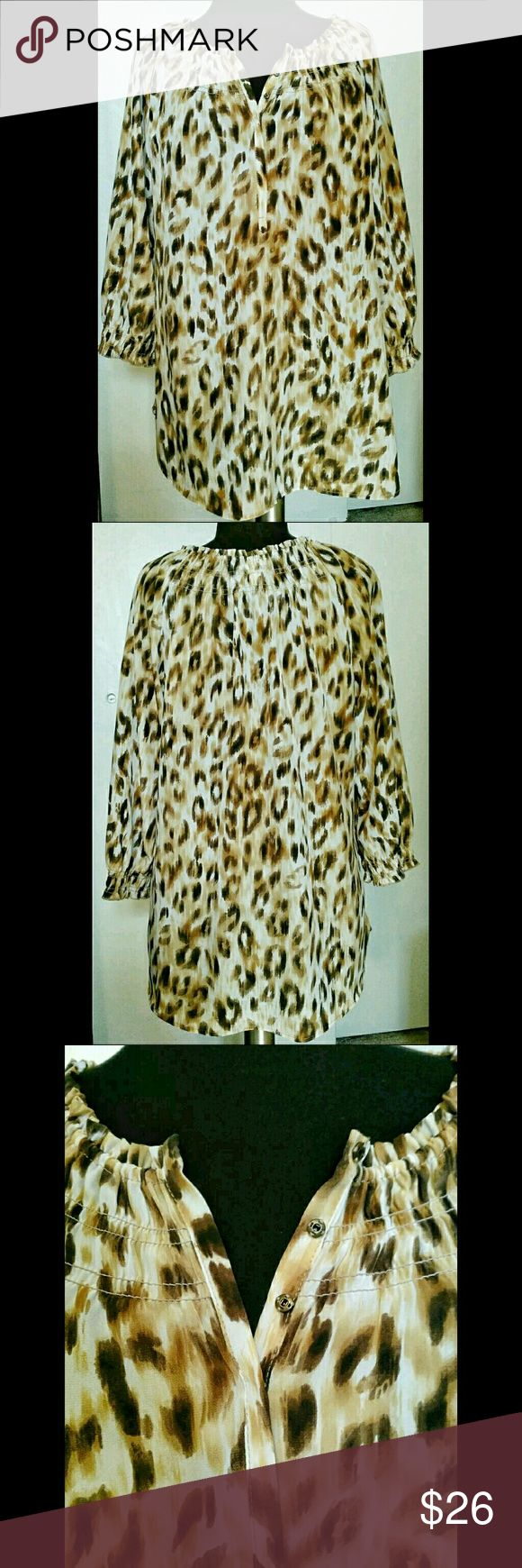 """Leopard Animal Print Tunic Chicos size 1 High quality premium lightweight leopard print tunic blouse   in the colors of brown, beige and cream with 3/4 sleeves.  7 snap closure at front and stretchy elastic at sleeve hem and neckline   BUST= 36 1/2"""" WAIST = 31"""" LENGTH= 29""""  Beautiful! Chico's Tops Tunics"""
