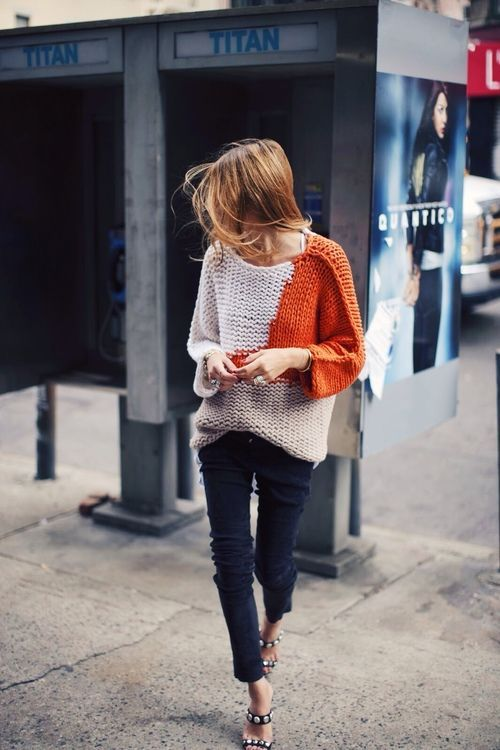 Oversized, Orange and Oatmeal Colored knit. Half-Tuck, Front Only. Black Trousers. Wind blown, ginger, layered bob. | LA COOL & CHIC